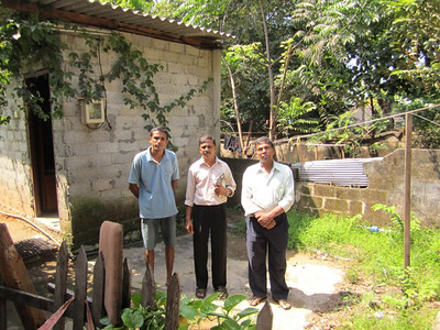 10 12-18  Damith along with FCH Sri Lanka coordinator and building supervisor standing on his land