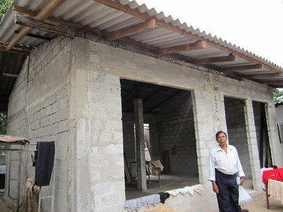11 01-03 Nilanthi's house constructed. The doors and windows will be installed by the family.