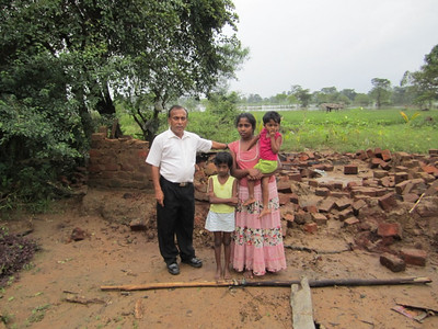 2011 02-08 JM Thissa Bandara, married with 2 children, standing in front of their collapsed house.   rj