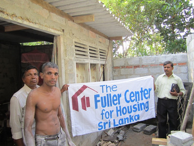 2011 02-14  Damith standing in front along with the Fuller staff.  The remaining work of plastering the walls, installing doors and windows and preparing the floor wil be done by the family. Ranjan