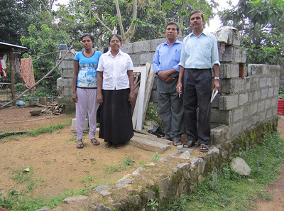 10 09-27 Ranjan (right) visits a family in Panadura who were not able to finish a house they started. The Fuller Center will provide building materials which will come with a no interest mortgage agreement.  ranjan