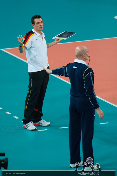 Giovanni Guidetti [GER Coach] protests to the assistant referee