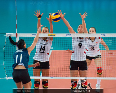 Margareta Kozuch and Corina Ssuschke-Voigt [GER] blocks an attacks by Georgina Pinedo [ARG]