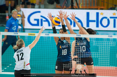 Yael Castiglione and Lucia Gaido [ARG] blocks an Heike Beier [GER] attacks