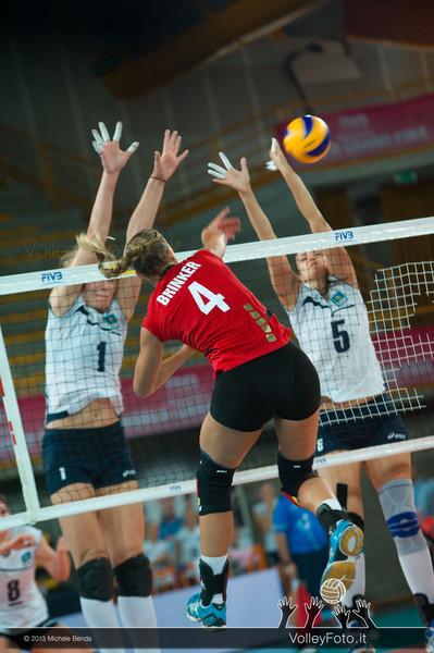 Maren Brinker [GER] attacks, Tatyana Mudritskaya (L) and Olga Nassedkina [KAZ] try to block