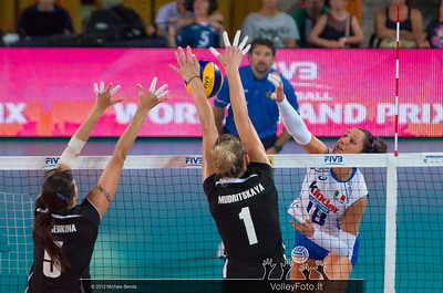 Tatyana Mudritskaya [KAZ] blocks the ball attacked by Carolina Costagrande [ITA]