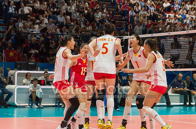 China, celebrates after scoring a point