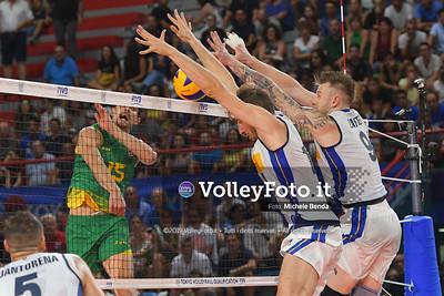 Matteo PIANO, blocks the ball spiked by, Luke SMITH, #15 of Australia