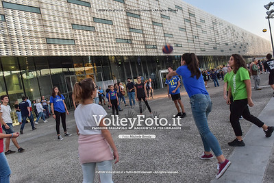Fans playing volleyball, waiting for the match