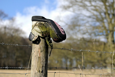 Boot on fence