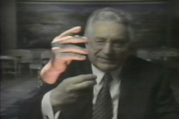 """BOARD (cntd):  Through a transparent screen hanging in the middle of the stage, you see my actual hands.  A camera captures the image of my hands, which Bob manipulates live, and simultaneously projects onto the screen itself, where the live image of my hands is mixed with pre-sampled images of hands involved in the Yugoslavian war.  There were moving video images, not only of people who had responsibility for the war on all sides, but also images of refugees, and of people who had lost everything because of this highly technological war.  While my hands interacted with the these images, I used my feet to control foot pedals that would zoom the video images in, or out.  I also used my feet to control the dimming of the lights around my own hands, so we could light them from above, or below, to match the images my hands were interacting with on the screen, and look like they were really a part of the image.  Whether it be the gesticulating hands of political figures lit from above by sunlight, hands of refugees lit from underneath by a fire at a refugee camp, or military figures playing chess by artificial light in their tent.      <br /> <br /> For me, the idea was primarily that, even though the war in Yugoslavia was highly technological, which is referred to in the first half of the piece, """"War Games,"""" no matter how much technology is involved, it comes down to the individual acts of individual people; that war, no matter what the intention, hurts people on the ground.  So I like the interplay between my own hands, very small in a large, dark space, and the amount of technology that it took to project and interact with the music and video.          <br /> <br /> ELKINS:  I'm curious if there was a difference between what you hoped this piece would accomplish, and what it actually accomplished.  <br /> <br /> BOARD:  I hoped a couple of things.  I knew very little about the conflict in Yugoslavia going in...that was Bob's department....and I was ambivalent about th"""