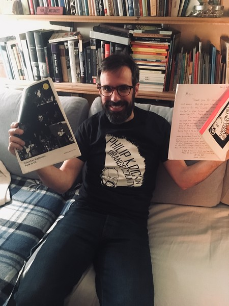 "After receiving his package of zines + homemade Philip K. Dick t-shirt, Miguel sent this ""happiness picture"".  Miguel in turn sent a vinyl release of his ""Extinción De Los Insectos"" EP."