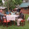 Charlie, Alex & Sugar enjoy African beer while the women fix dinner.