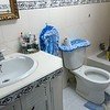 Typical family bathroom.  Toilet seats are far and few between.  One seat costs nearly $400 US.