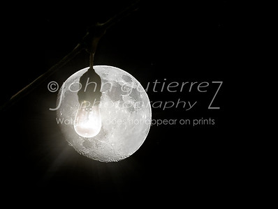 Moon behind a light bulb