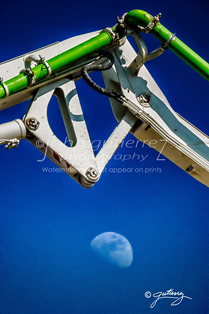 Cement crane aginst the moon