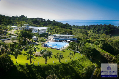 Aerial view of the Hotel. Embedded on a hill between the Pacific Ocean and rainforest-covered mountains.