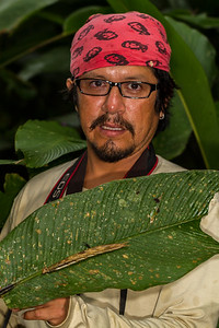 Fernando Vaca and a giant caterpillar, Caligo sp. (Nymphalidae). Bates Trail, Shiripuno, Orellana Ecuador
