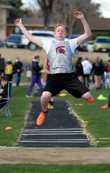 Berthoud's Kaden Sandvik competes in the long jump Thursday, April 18, 2019, during the Lee Schwab invitational track meet at Loveland High School.  (Photo by Jenny Sparks/Loveland Reporter-Herald)