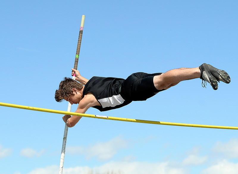 Loveland's Logan Rust pole vaults Thursday, April 18, 2019, during the Lee Schwab invitational track meet at Loveland High School.  (Photo by Jenny Sparks/Loveland Reporter-Herald)