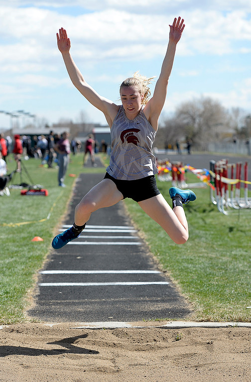. Berthoud\'s McKayla Milan competes in the triple jump Thursday, April 18, 2019, during the Lee Schwab invitational track meet at Loveland High School.  (Photo by Jenny Sparks/Loveland Reporter-Herald)