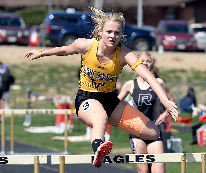 Thompson Valley's Lindsey Fancher-Owen runs the 300 meter hurdles Thursday, April 18, 2019, during the Lee Schwab invitational track meet at Loveland High School.  (Photo by Jenny Sparks/Loveland Reporter-Herald)
