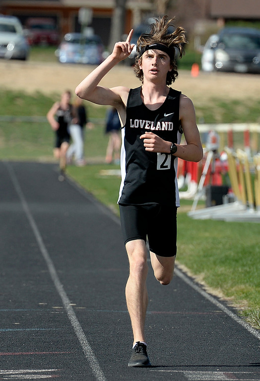 . Loveland\'s Zac Witman reacts as he crosses the finish first in the 3200 meter run Thursday, April 18, 2019, during the Lee Schwab invitational track meet at Loveland High School.  (Photo by Jenny Sparks/Loveland Reporter-Herald)
