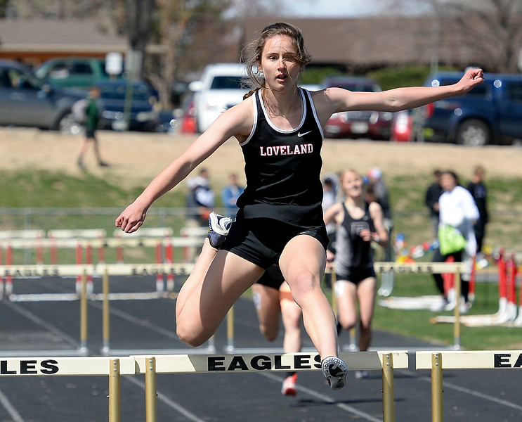 Loveland's Claira Gilchrist leads the pack in the 300 meter hurdles Thursday, April 18, 2019, during the Lee Schwab invitational track meet at Loveland High School.  (Photo by Jenny Sparks/Loveland Reporter-Herald)