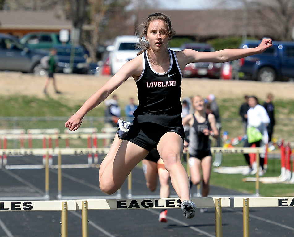 . Loveland\'s Claira Gilchrist leads the pack in the 300 meter hurdles Thursday, April 18, 2019, during the Lee Schwab invitational track meet at Loveland High School.  (Photo by Jenny Sparks/Loveland Reporter-Herald)