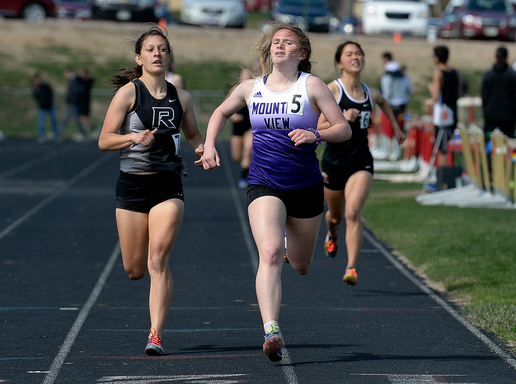 . Roosevelt\'s Kelsey Lagunas, left, Mountain View\'s Taylor Petty, center, and Loveland\'s Callie Velarde head toward the finish line in the 800 meter Thursday, April 18, 2019, during the Lee Schwab invitational track meet at Loveland High School.  (Photo by Jenny Sparks/Loveland Reporter-Herald)