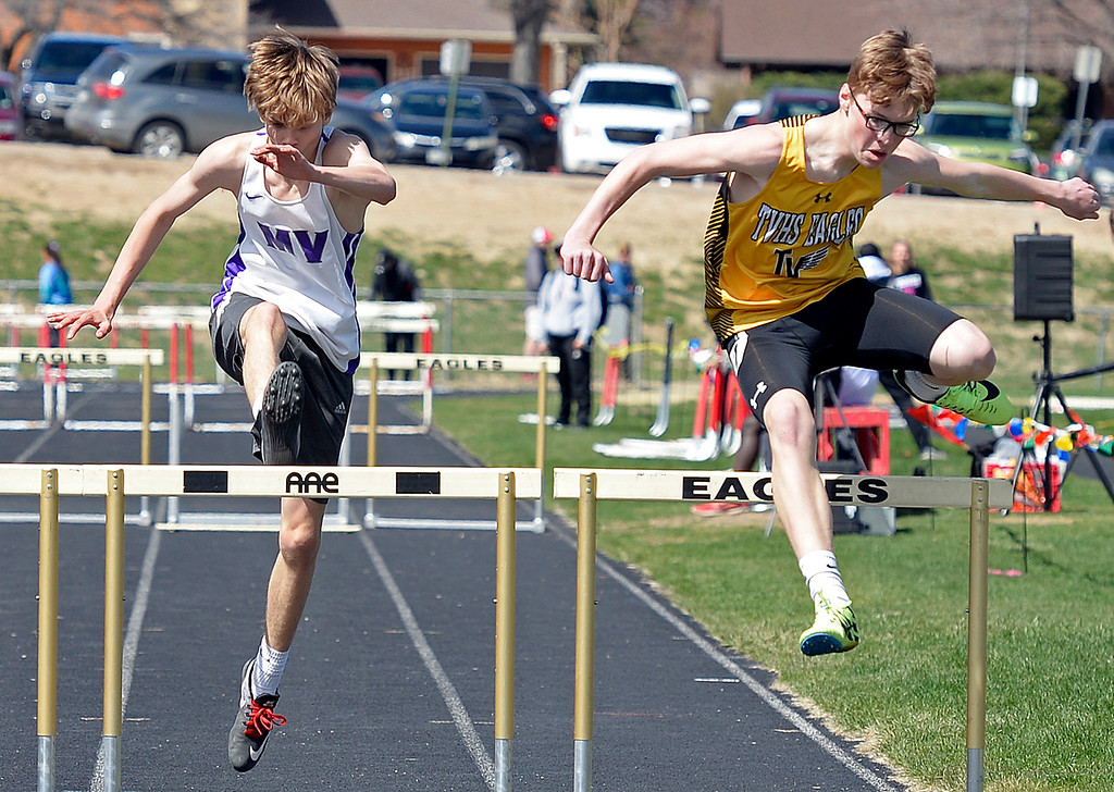 . Mountain View\'s Bennett Feldenkirchen and Thompson Valley\'s Ethan Charles 300 meter hurdles Thursday, April 18, 2019, during the Lee Schwab invitational track meet at Loveland High School.  (Photo by Jenny Sparks/Loveland Reporter-Herald)