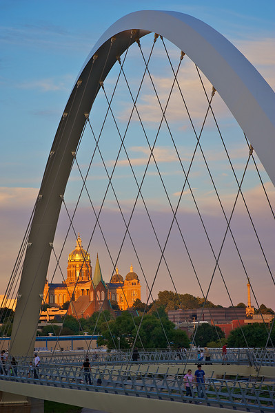 Sun setting on state capital through walking bridge