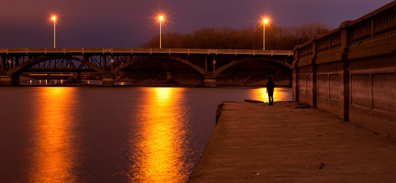 Bridge at night with spectator