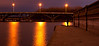 Bridge at night with spectator
