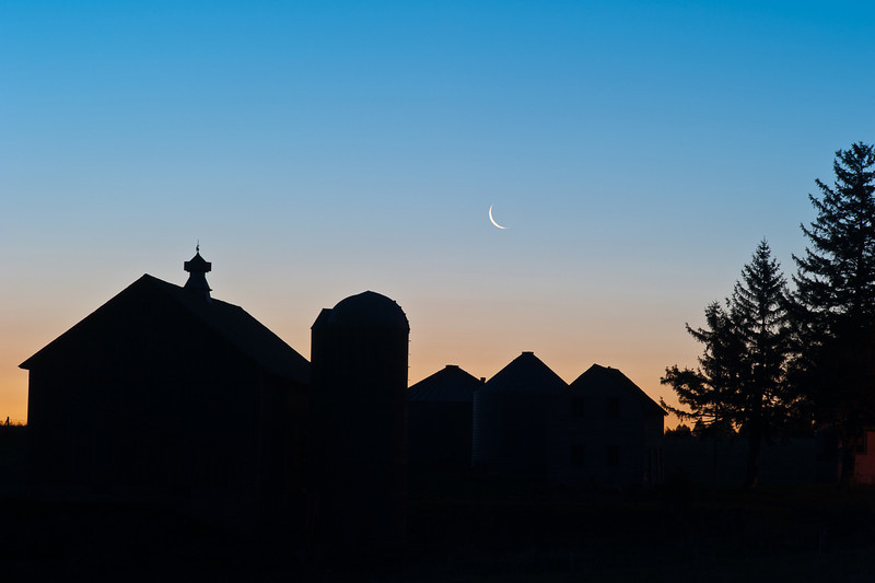 Farm silhouette and moon