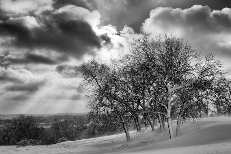 Sun breaking through winter clouds