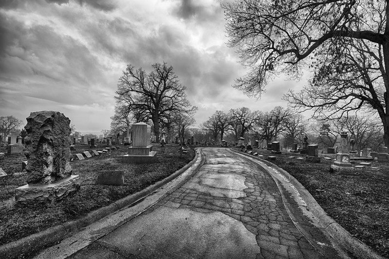 Cracked road in cemetery