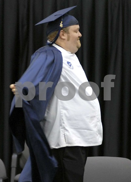 -Messenger photo by Hans Madsen<br /> <br /> The Culinary Arts graduates, including Wesley Zeitz, of Humboldt, took off their blue robes as they walked across the state to get their diplomas in their chef's whites during the 48th annual Iowa Central Community College Commencement Friday evening.