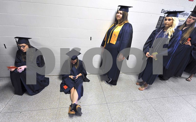 -Messenger photo by Hans Madsen<br /> <br /> Miranda Simpson, of Manson, keeps on her text messages while waiting for the 48th annual Iowa Central Community College Commencement to get underway Friday evening.