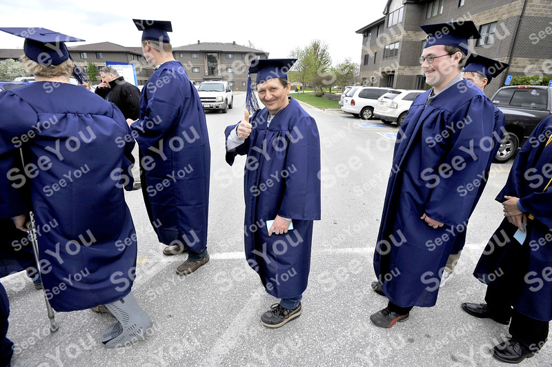 -Messenger photo by Hans Madsen<br /> <br /> Patrick Ackerson, of Fort Dodge, gives the day a thumbs up while waiting for the Iowa Central Community College commencement to start Thursday afternoon. Ackerson graduated from the Electrical Tech program.