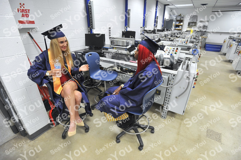 -Messenger photo by Hans Madsen<br /> <br /> Paulina Jankun, of Elblag, Poland, at left, finds a quiet place in a classroom to wait for commencement exercises to start with her friend Nyajal Mayan, of Nasir, South Sudan.