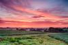 Sunrise over central Iowa farm ground.