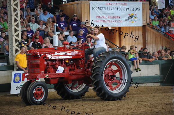 Meghan Miller, of the North Scott FFA chapter in Eldridge rides a restored tractor in the FFA Parade of Champions at the Iowa State Fair on Aug. 10. (Iowa State Fair/ Steve Pope Photography)