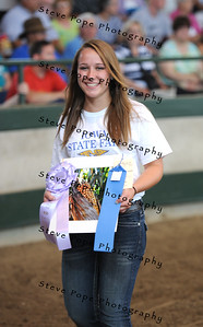 Elle Gerhke, of the Des Moines FFA Chapter, presents her Best of Show Photograph in the FFA Parade of Champions at the Iowa State Fair on Aug. 10. (Iowa State Fair/ Steve Pope Photography)
