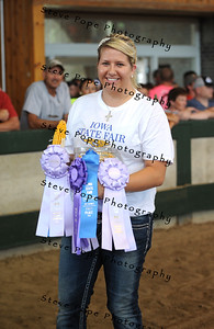 Kelley Glanz of the West Delaware FFA chapter at Manchester, received Champion and Reserve Champion Field Corn exhibit, Champion and Reserve Champion Soybean exhibit, and Reserve Champion Premier Exhibitor Award in the FFA Parade of Champions at the Iowa State Fair on Aug. 10. (Iowa State Fair/ Steve Pope Photography)