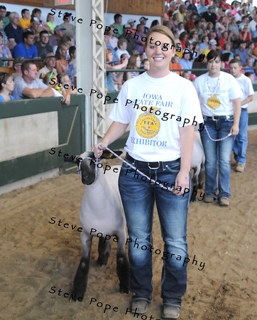 Grand Champion Market Lamb was awarded to Jessica Marty, from the Corwith-Wesley-LuVerne FFA chapter at Corwith, in the FFA Parade of Champions at the Iowa State Fair on Aug. 10. (Iowa State Fair/ Steve Pope Photography)