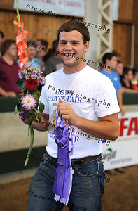 Grant Hammes, of the Wilton FFA chapter, received Champion Dahlia, Champion Zinnia, Reserve Champion Rose, and Reserve Champion Gladiola in the FFA Parade of Champions at the Iowa State Fair on Aug. 10. (Iowa State Fair/ Steve Pope Photography)