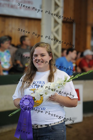 Calise Hammes, of the Wilton FFA chapter, received Champion Gladiola exhibit in the FFA Parade of Champions at the Iowa State Fair on Aug. 10. (Iowa State Fair/ Steve Pope Photography)