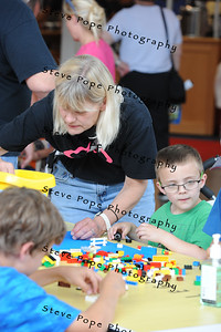 Kathy Wiebbecke, of St. Ansgar, builds Legos with Casey Greiman, 5, in the Varied Industries Building at the Iowa State Fair on Aug. 8. (Iowa State Fair/ Steve Pope Photography)