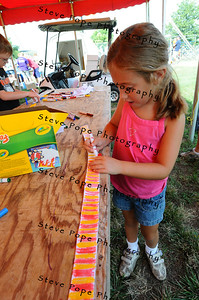 Six-year-old Abby Deal, of Gilbert, colors a belt in the Blue Ribbon Kids' Club at the Iowa State Fair on Aug. 8. (Iowa State Fair/ Steve Pope Photography)